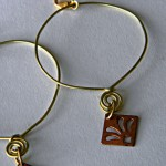 Brass hoop with Copper drop